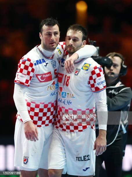 Domagoj Duvnjak and Igor Karacic of Croatia react after the Men's EHF EURO 2020 final match between Spain and Croatia at Tele2 Arena on January 26,...