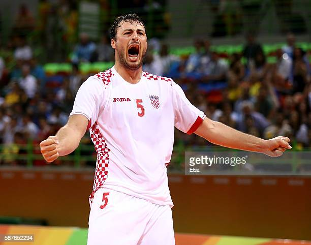 Domagoj Duvnjak of Croatia celebrates his goal in the first half against Argentina on Day 4 of the Rio 2016 Olympic Games at the Future Arena on...