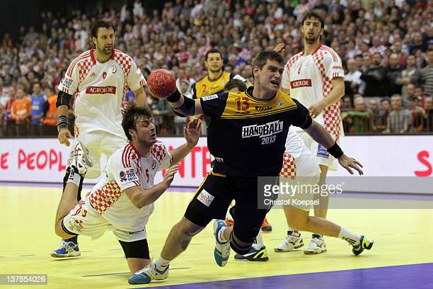 Domagoj Duvnjak of Croatia #ö defends against Julen Aguinagalde of Spain during the Men's European Handball Championship second round group two match...