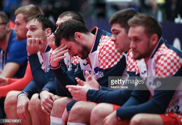 Domagoj Duvnjak of Croatia ponders from the substitute bench during the Men's EHF EURO 2020 main round group I match between Croatia and Czech...