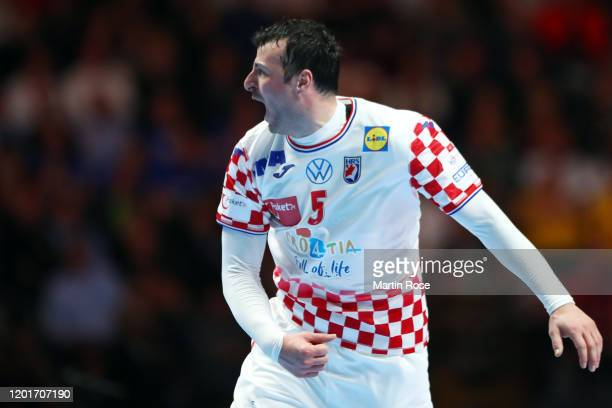 Domagoj Duvnjak of Croatia reacts during the Men's EHF EURO 2020 semi final match between Norway and Croatia at Tele2 Arena on January 24, 2020 in...
