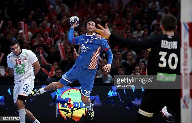Domagoj Duvnjak of Croatia scores over Torbjorn Bergerud goaltender of Norway during the 25th IHF Men's World Championship 2017 Semi Final match...