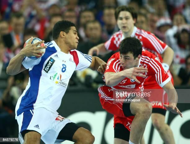 Domagoj Duvnjak of Croatia tackles Daniel Narcisse of France during the Men's World Handball Championships final match between France and Croatia at...