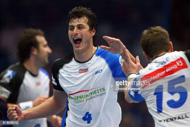 Domagoj Duvnjak of Hamburg celebrates a goal with Guillaume Gille during the Handball Bundesliga match between TBV Lemgo and THW Kiel at the...