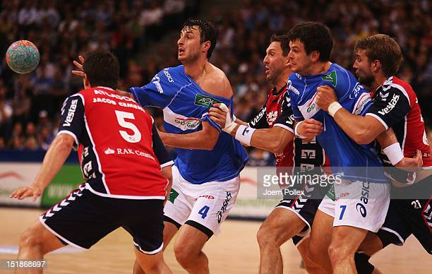 Domagoj Duvnjak of Hamburg is challenged by Tobias Karlsson during the DKB Handball Bundesliga match between HSV Hamburg and SG FlensburgHandewitt at...