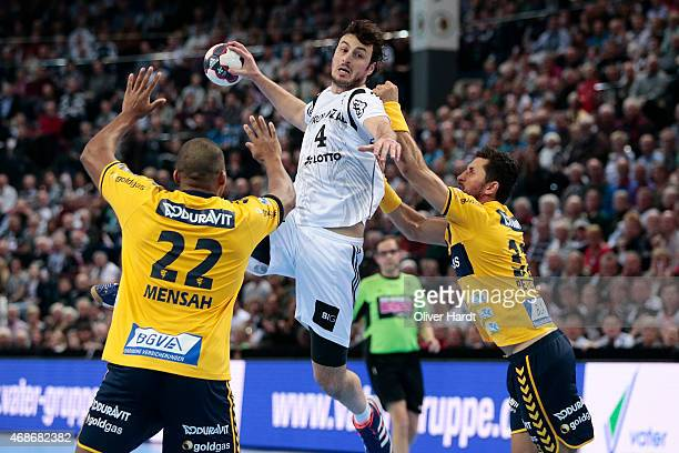 Domagoj Duvnjak of Kiel challenges for the ball with Uwe Gensheimer of Rhein Neckar during the DKB HBL Bundesliga match between THW Kiel and Rhein...