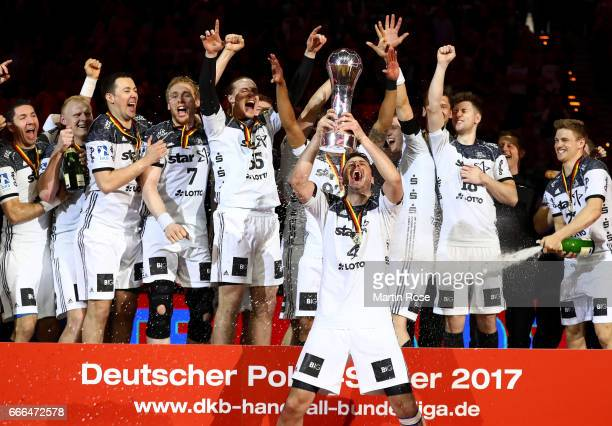 Domagoj Duvnjak of Kiel lifts the trophy after winning the Rewe Final Four final match between SG FlensburgHandewitt and Thw Kiel at Barclaycard...