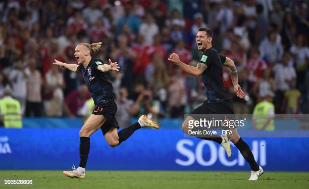 Domagoj Vida and Dejan Lovren of Croatia celebrate their victory after the extra time penalty shootout during the 2018 FIFA World Cup Russia Quarter...
