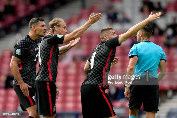 Domagoj Vida and Mateo Kovacic of Croatia interacts with Match Referee, Carlos del Cerro Grande after he awards Czech Republic a penalty during the...
