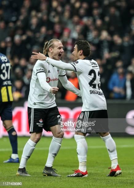 Domagoj Vida and Shinji Kagawa of Besiktas celebrate after Gokhan Gonul's goal during Turkish Super Lig soccer match between Fenerbahce and Besiktas...