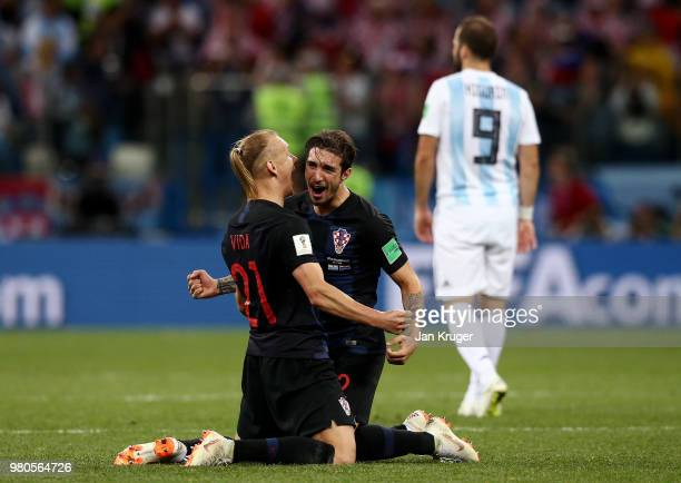 Domagoj Vida and Sime Vrsaljko of Croatia celebrate victory following the 2018 FIFA World Cup Russia group D match between Argentina and Croatia at...