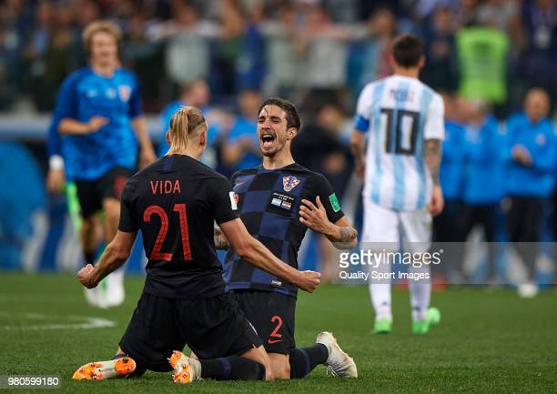 Domagoj Vida and Sime Vrsaljko of Croatia celebrates his team victori at the end of the 2018 FIFA World Cup Russia group D match between Argentina...