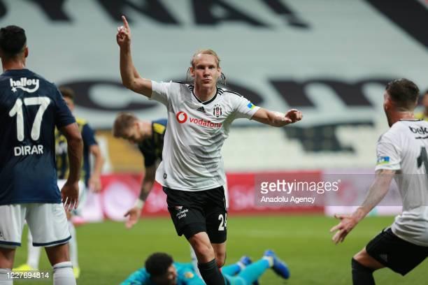 Domagoj Vida of Besiktas celebrates after scoring a goal during the Turkish Super Lig week 33 soccer match between Besiktas and Fenerbahce at...