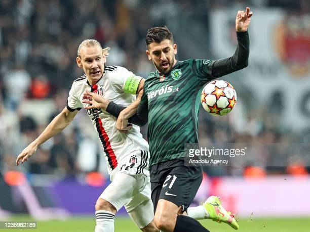 Domagoj Vida of Besiktas in action against Paulinho of Sporting Lizbon during UEFA Champions League Group C soccer match between Besiktas and...