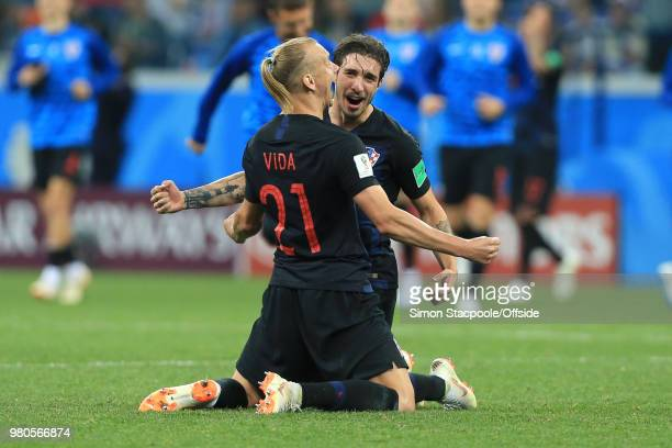 Domagoj Vida of Croatia and Sime Vrsaljko of Croatia celebrate their 3-0 win during the 2018 FIFA World Cup Russia Group D match between Argentina...