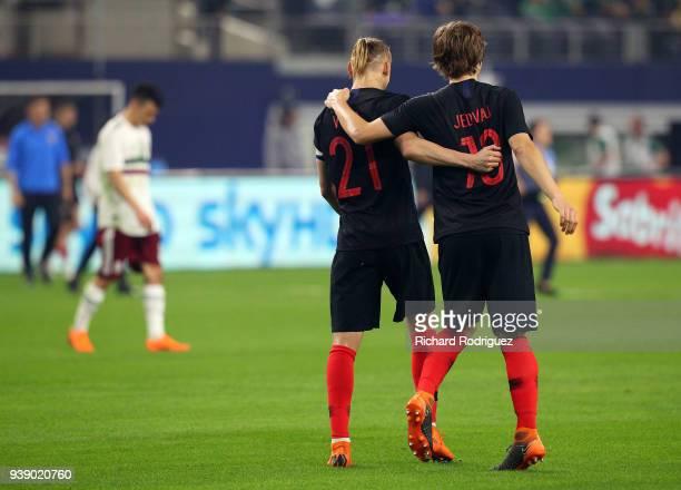 Domagoj Vida of Croatia and Tin Jedvaj of Croatia hug after the 10 win over Mexico in an intetnational friendly soccer match at ATT Stadium on March...