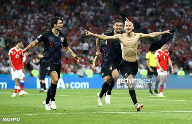 Domagoj Vida of Croatia celebrates after scoring his team's second goal with team mates Dejan Lovren and Vedran Corluka during the 2018 FIFA World...
