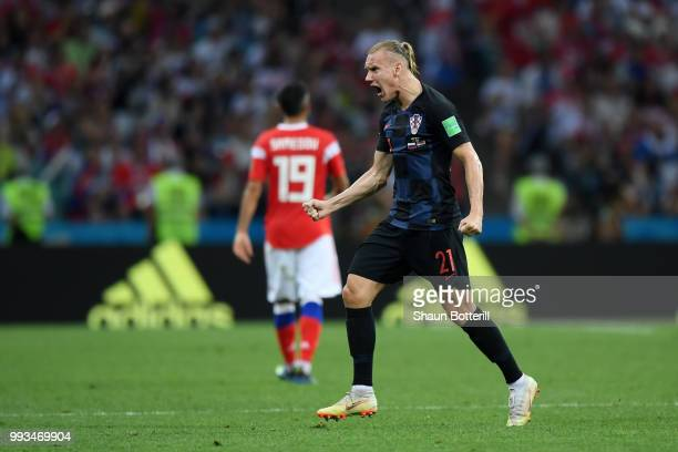 Domagoj Vida of Croatia celebrates after teammate Andrej Kramaric scores their team's first goal during the 2018 FIFA World Cup Russia Quarter Final...