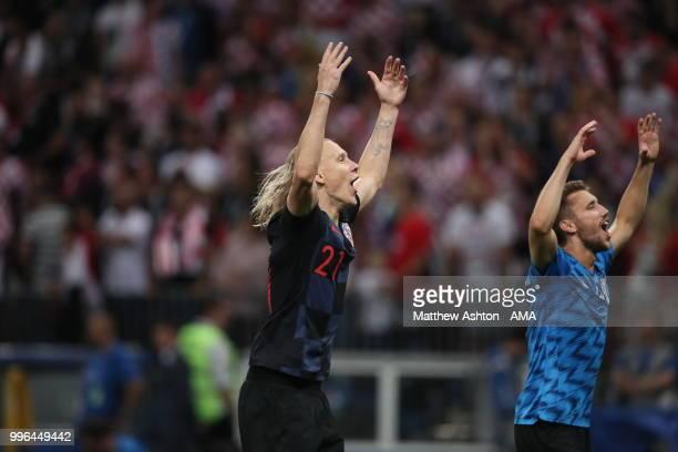 Domagoj Vida of Croatia celebrates at full time during the 2018 FIFA World Cup Russia Semi Final match between England and Croatia at Luzhniki...