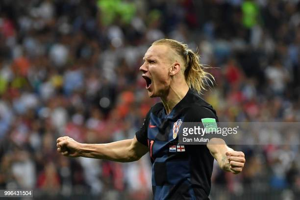 Domagoj Vida of Croatia celebrates following his sides victory in the 2018 FIFA World Cup Russia Semi Final match between England and Croatia at...