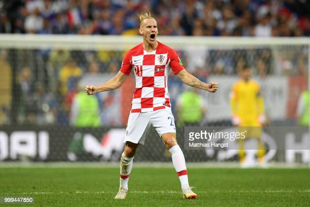 Domagoj Vida of Croatia celebrates his side's first goal scored by team mate Ivan Perisic during the 2018 FIFA World Cup Final between France and...
