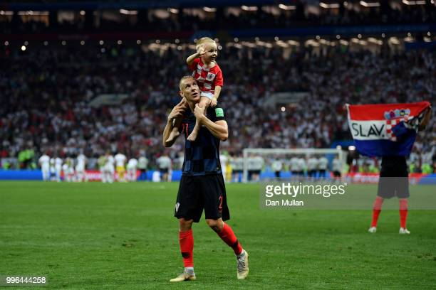 Domagoj Vida of Croatia celebrates with his son following his sides victory in the 2018 FIFA World Cup Russia Semi Final match between England and...