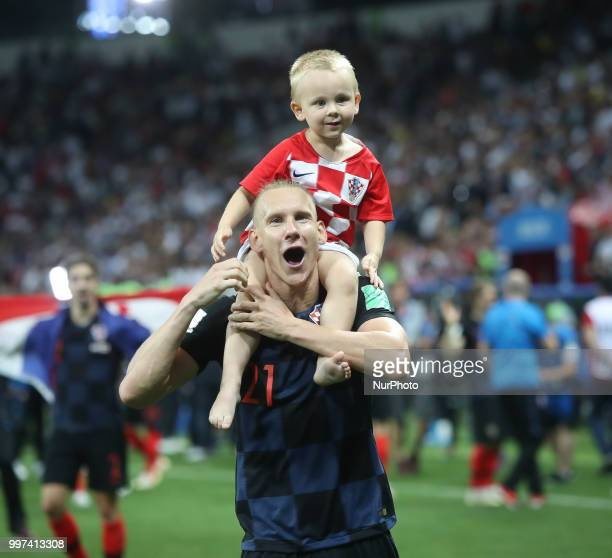 Domagoj Vida of Croatia celebrates with his son following his sides victory in 2018 FIFA World Cup Russia Semi Final match between England and...