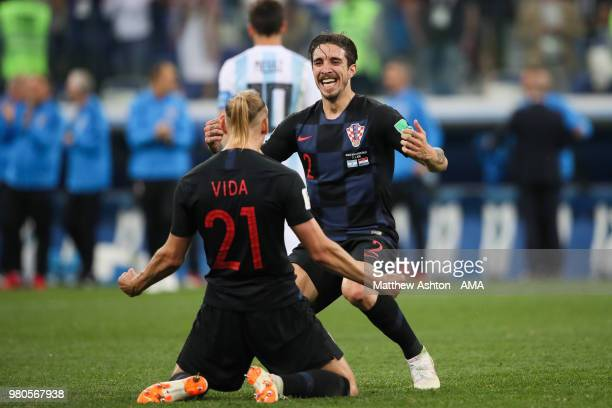 Domagoj Vida of Croatia celebrates with Sime Vrsaljko at the end of the 2018 FIFA World Cup Russia group D match between Argentina and Croatia at...