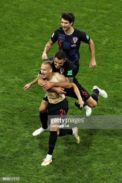 Domagoj Vida of Croatia celebrates with teammate Dejan Lovren after scoring his team's second goal during the 2018 FIFA World Cup Russia Quarter...
