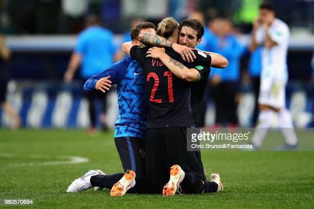 Domagoj Vida of Croatia celebrates with teammate Sime Vrsaljko after the 2018 FIFA World Cup Russia group D match between Argentina and Croatia at...