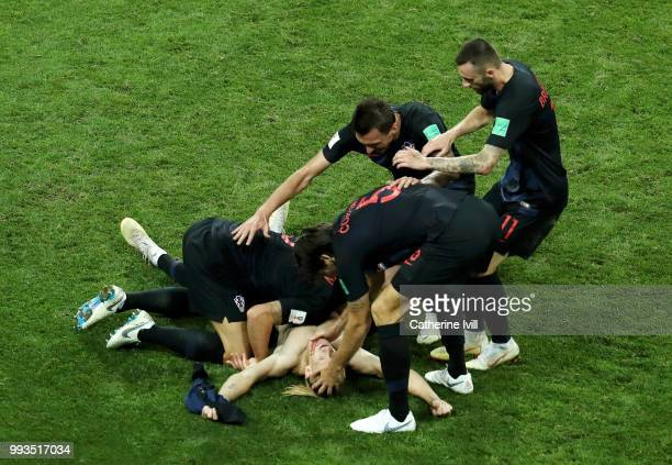 Domagoj Vida of Croatia celebrates with teammates after scoring his team's second goal during the 2018 FIFA World Cup Russia Quarter Final match...