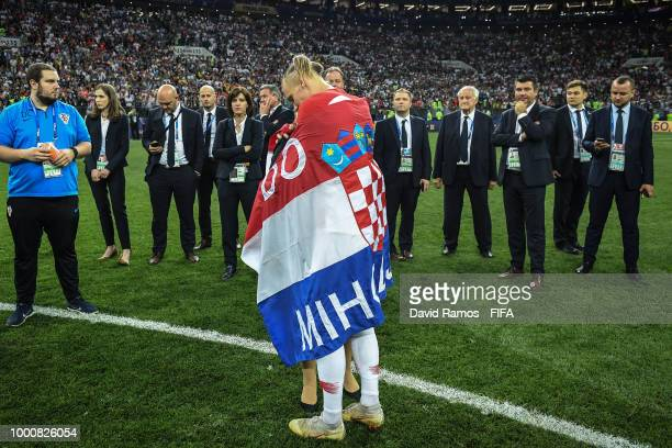 Domagoj Vida of Croatia is conforted by a member of the stauff after beinf defeated by France in the 2018 FIFA World Cup Russia Final between France...