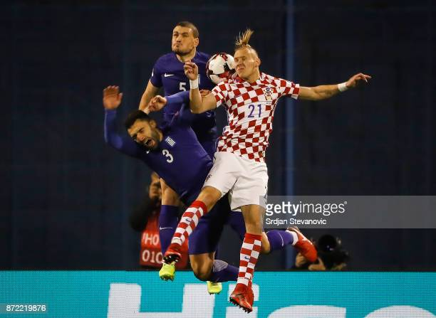 Domagoj Vida of Croatia jump for the ball against Kyriakos Papadopoulos and Giorgos Tzavellas of Greece during the FIFA 2018 World Cup Qualifier...