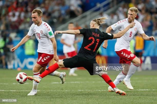 Domagoj Vida of Croatia national team vies for the ball with Christian Eriksen and Nicolai Jorgensen of Denmark national team during the 2018 FIFA...