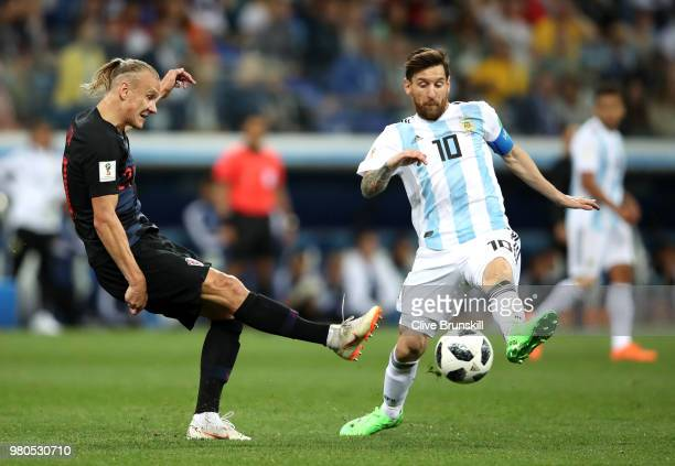 Domagoj Vida of Croatia passes the ball past Lionel Messi of Argentina during the 2018 FIFA World Cup Russia group D match between Argentina and...