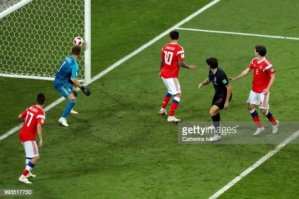 Domagoj Vida of Croatia scores past Igor Akinfeev of Russia his team's second goal during the 2018 FIFA World Cup Russia Quarter Final match between...