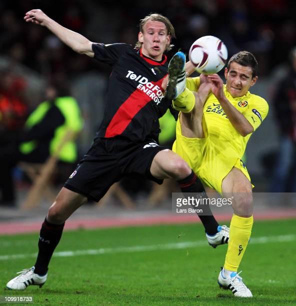 Domagoj Vida of Leverkusen challenges Marco Ruben of Villarreal during the UEFA Europa League round of 16 first leg match between Bayer Leverkusen...