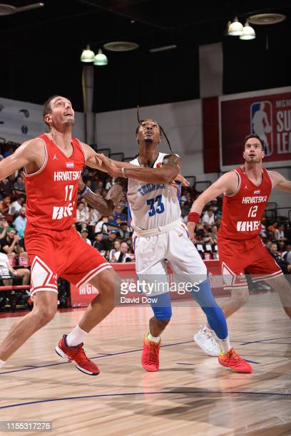 Domagoj Vukovic of Croatia and Emanuel Terry of the Oklahoma City Thunder fights for position to grab the rebound during Day 8 of the 2019 Las Vegas...