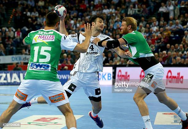 Domagoj Vuvnjak of Kiel challenges for the ball with Manuel Spaeth of Goeppingen during the DKB HBL Bundesliga match between THW Kiel and Frisch Auf...