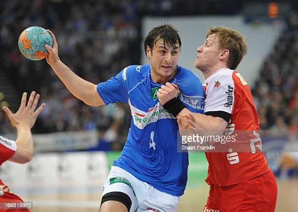 Domanagoj Duvnjak of Hamburg is challenged by Niclas Pieczkowski of Essen during the DKB Bundesliga handball game between HSV Hamburg and TUSEM Essen...