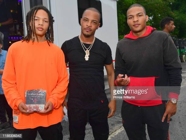 Domani Harris, T.I., and Messiah Harris during the 2019 Tycoon Music Festival at Cellairis Amphitheatre at Lakewood on June 8, 2019 in Atlanta,...