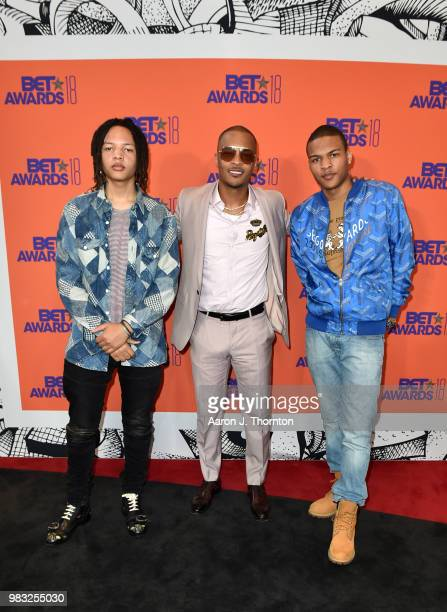 Domani Harris, T.I. And Messiah Ya' Majesty Harris pose in the press room at the 2018 BET Awards at Microsoft Theater on June 24, 2018 in Los...