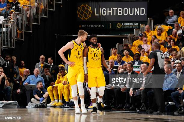 Domantas Sabonis and Tyreke Evans of the Indiana Pacers looks on against the Boston Celtics during Game Four of Round One of the 2019 NBA Playoffs on...