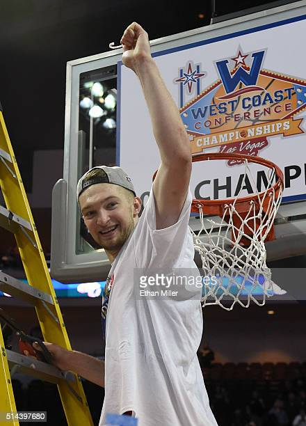 Domantas Sabonis of the Gonzaga Bulldogs cuts a piece of a net after defeating the Saint Mary's Gaels 8575 to win the championship game of the West...