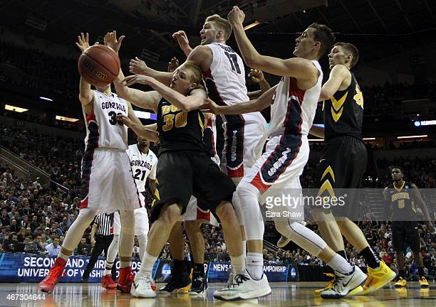 Domantas Sabonis of the Gonzaga Bulldogs fights for the rebound against Aaron White of the Iowa Hawkeyes in the second half of the game during the...