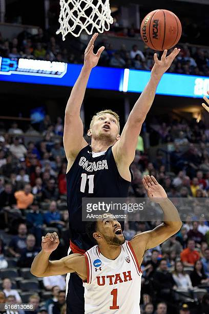 Domantas Sabonis of the Gonzaga Bulldogs goes over the back of Isaiah Wright of the Utah Utes during the second half of Gonzaga's 8259 second round...