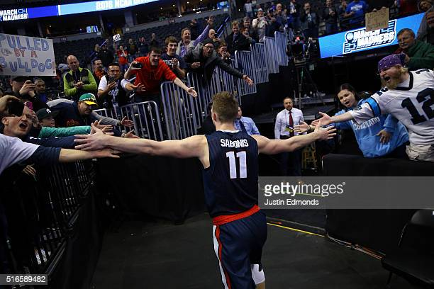 Domantas Sabonis of the Gonzaga Bulldogs walks to the locker room as he highfives fans after defeating the Utah Utes with a score of 82 to 59 during...
