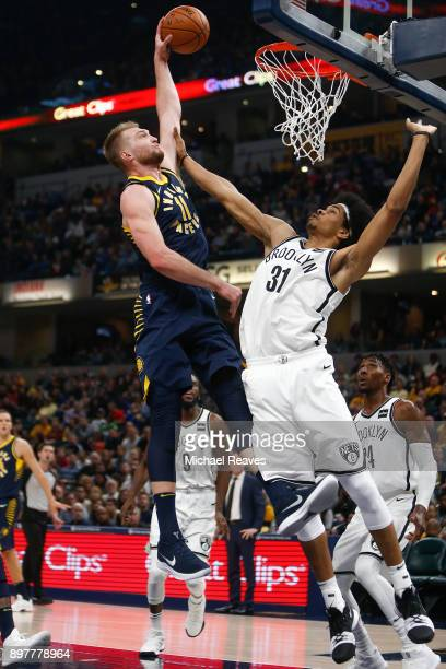 Domantas Sabonis of the Indiana Pacers dunks the ball against Jarrett Allen of the Brooklyn Nets during the first half at Bankers Life Fieldhouse on...