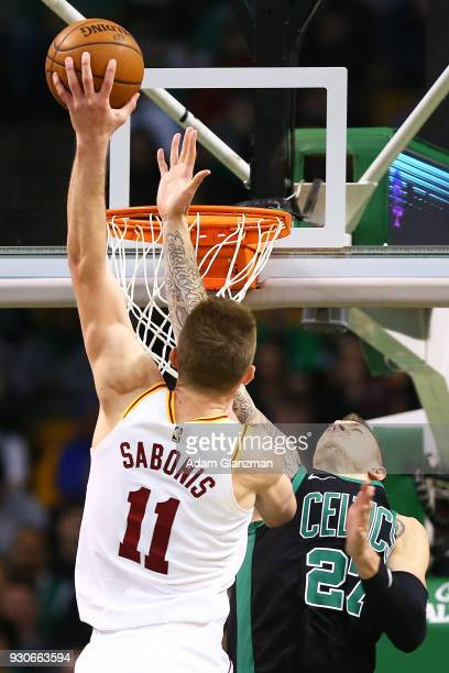 Domantas Sabonis of the Indiana Pacers dunks the ball over Daniel Theis of the Boston Celticsduring a game at TD Garden on March 11 2018 in Boston...