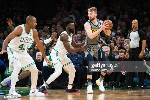 Domantas Sabonis of the Indiana Pacers is defended by Jaylen Brown of the Boston Celtics at TD Garden on March 29 2019 in Boston Massachusetts NOTE...
